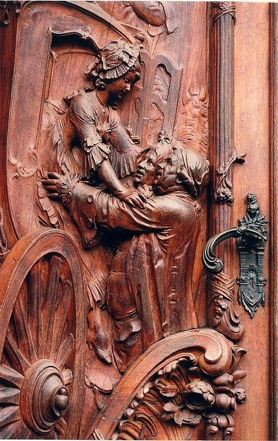Photo:  A carved wooden door in Worms, Germany.