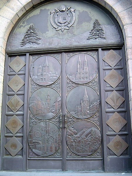 Photo:  Bronze Medallions from Doors of the dining room of the SS Normandie, now adorn the front doors of Our Lady of Lebanon Roman Catholic Church in Brooklyn Heights