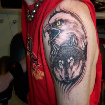 Photo:  wolf-head-and-eagle-tattoo-on-left-shoulder