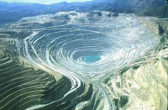 Photo:  Bingham Canyon Mine, Utah, USA, is the biggest open pit mine and the largest, deepest human excavation in the world