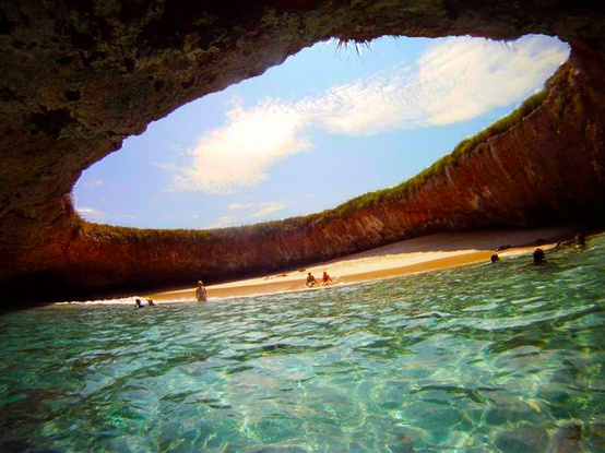 Photo:  The Marieta Islands where a water tunnel leads you to this hidden beach