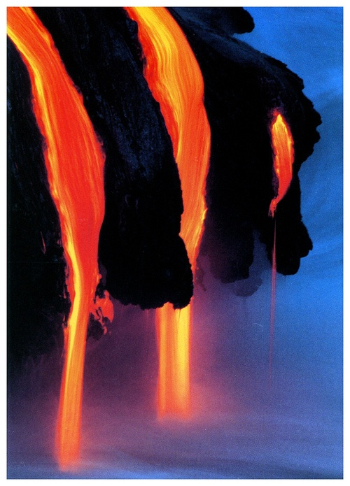 Photo:  Lava flowing into the ocean at Hawaii Volcanoes National Park