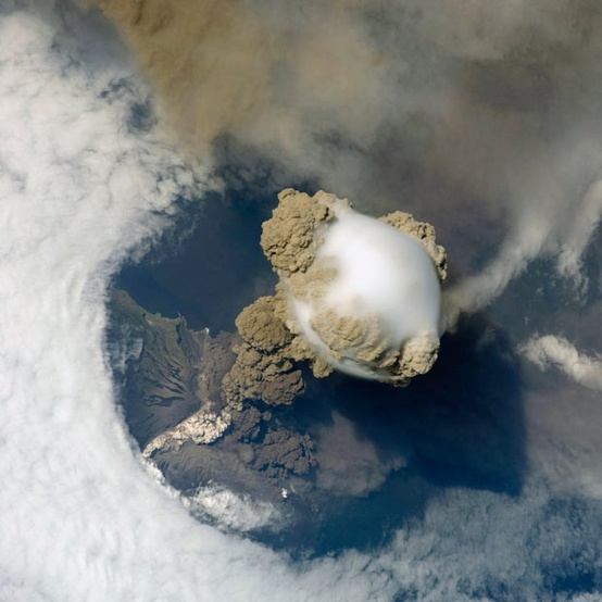 Photo:  large plume of smoke, steam and ash erupting from the Sarychev volcano on the Kuril Islands, Russia