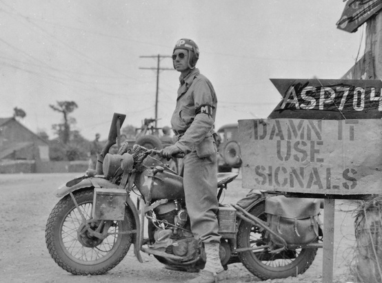 Photo:  American MP and ubiquitous Harley Davidson photographed on July 20, 1944