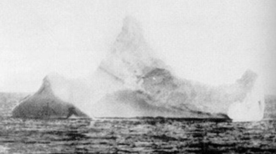 Photo:  photo of the iceberg that sank Titanic (by the chief steward of SS Prinz Adalbert).Its identity was confirmed by a red streak of paintwork scraped across its base