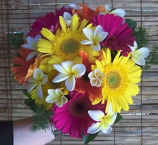 Photo:  tropical looking gerbera daisy wedding bouquet.