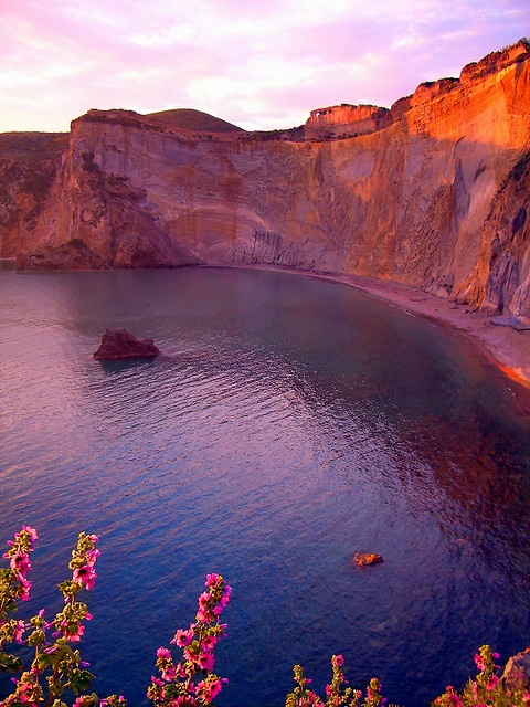Photo:  Beach and wild flowers at dusk. Chiaia di Luna Beach, Ponza Island, Pontine Islands, Lazio, Italy