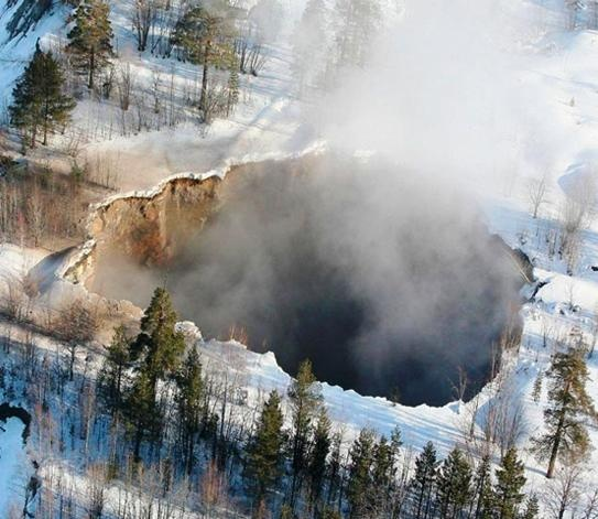 Photo:  A 200 ft wide massive Sinkhole opens up in Sweden