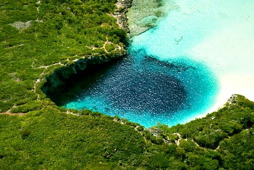 Photo:  Blue Hole on Long Island in the Bahamas is the world's deepest at more than 600 feet deep.
