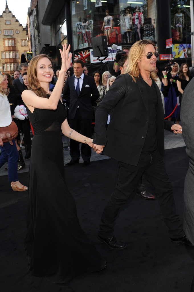 Photo:  Angelina Jolie (in Saint Laurent) and Brad Pitt at the London premiere of World War Z, June 2nd 2013