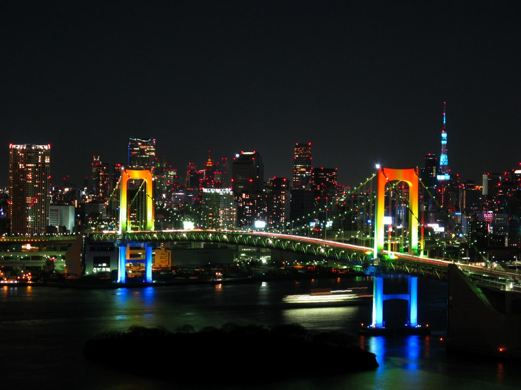 Photo:  Rainbow_colored_Rainbow_Bridge_at_night