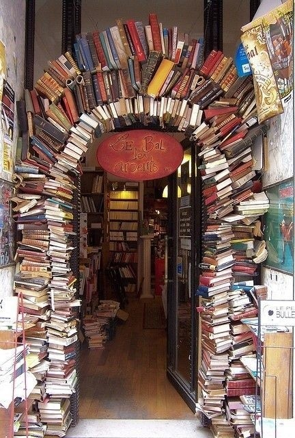 Photo:  archway built completely from books