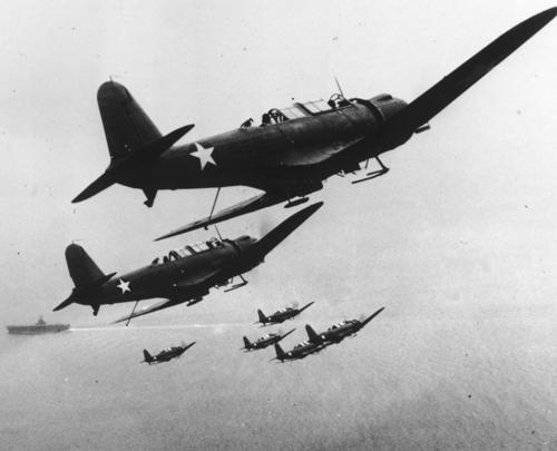 Photo:  1942 Six U.S. Navy scout planes are seen in flight above their carrier.