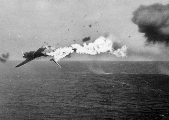 Photo:  A Japanese torpedo bomber goes down in flames after a direct hit by 5